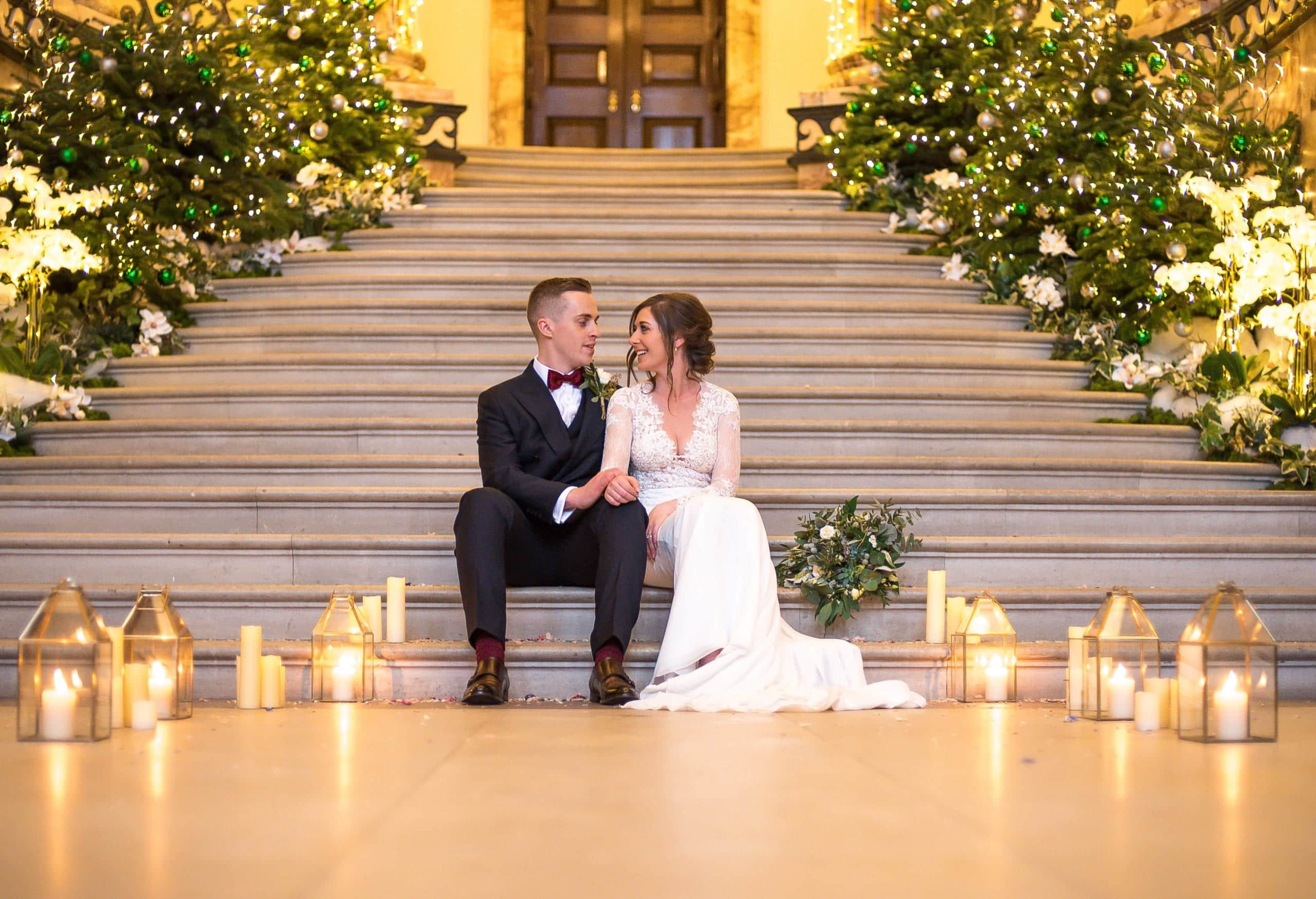 Wedding cuddles at Holkham Hall's Marble Room
