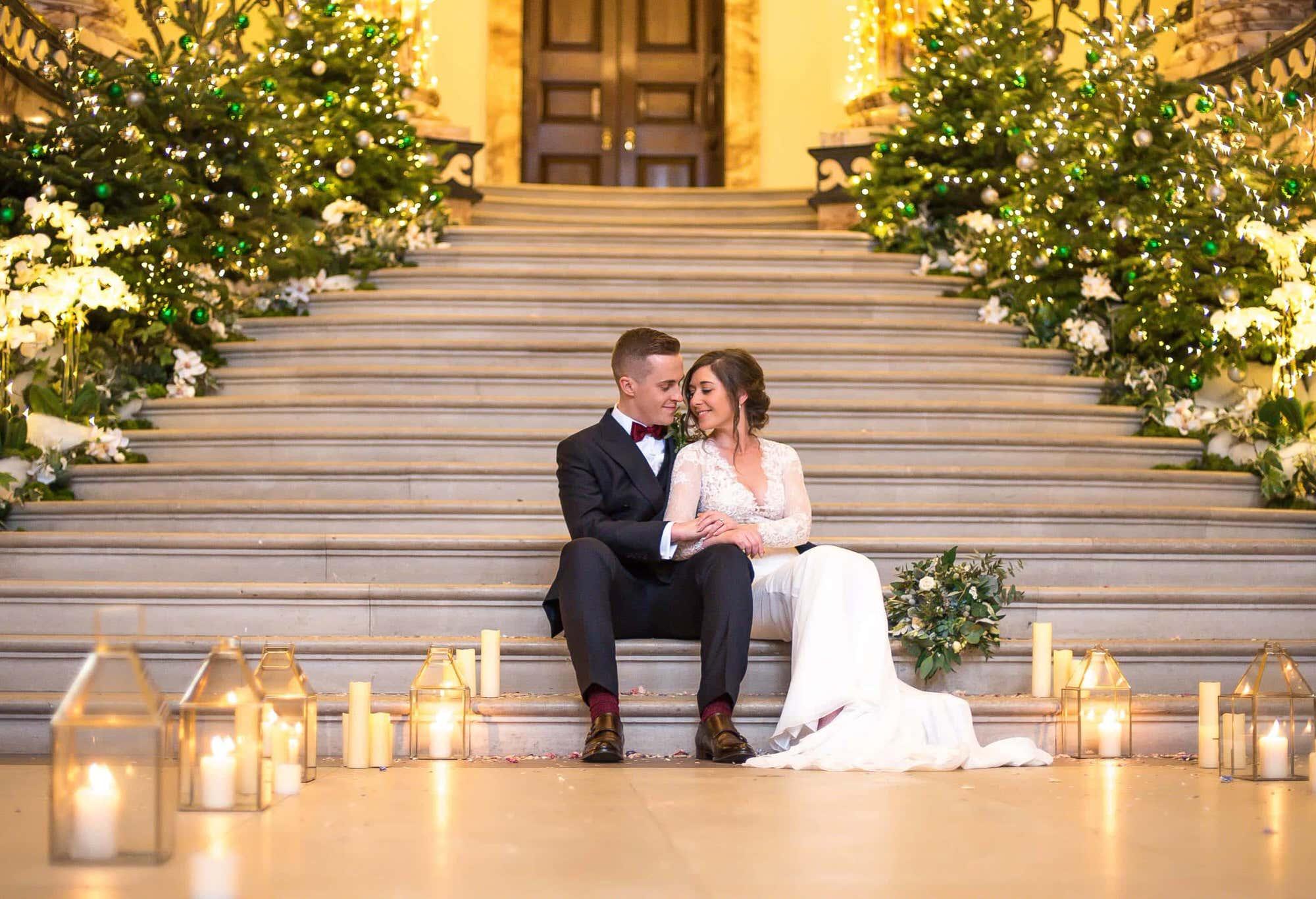 Newly Weds cuddling at Holkham Hall Weddings