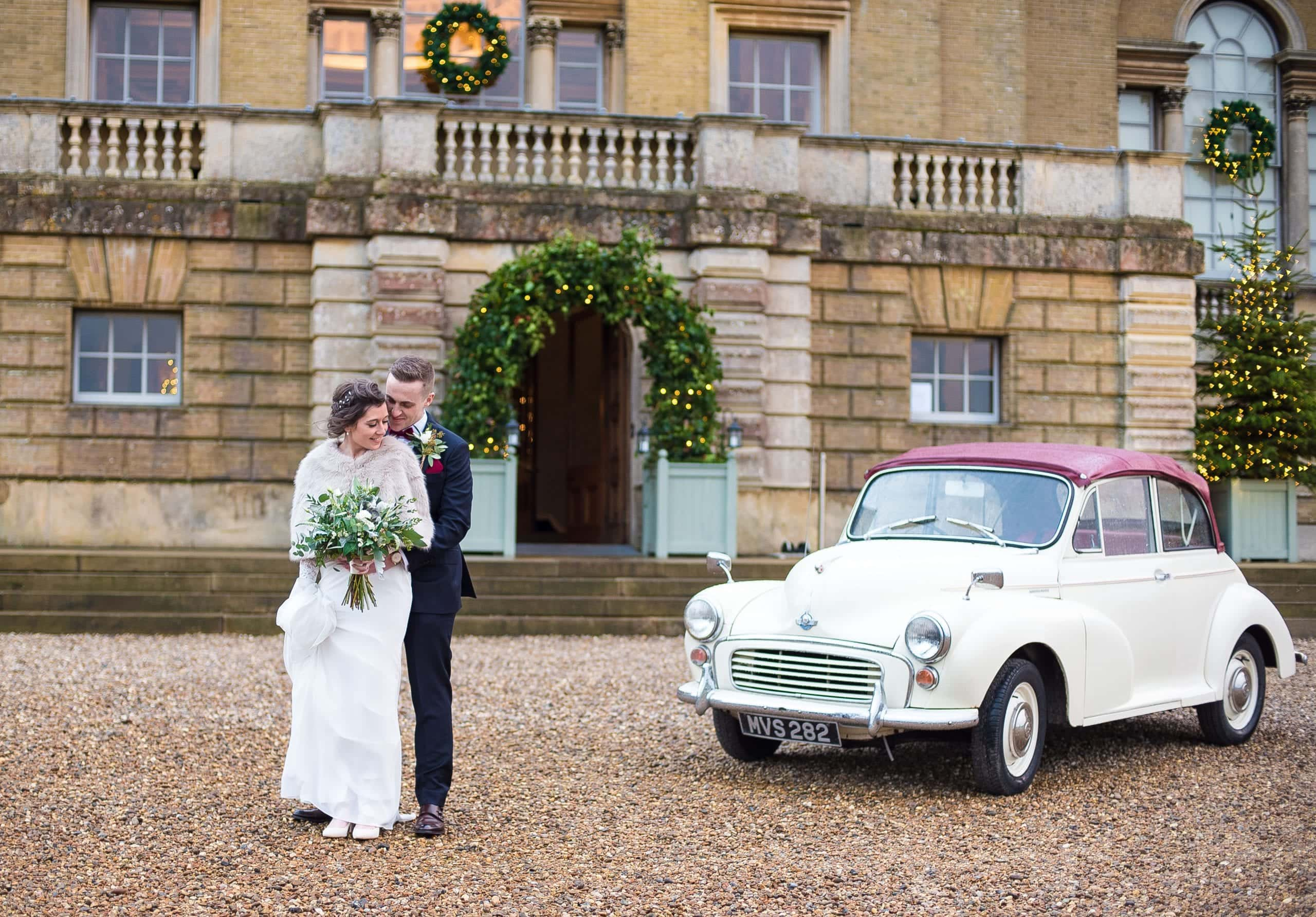 Winter wedding day snuggles at Holkham Hall