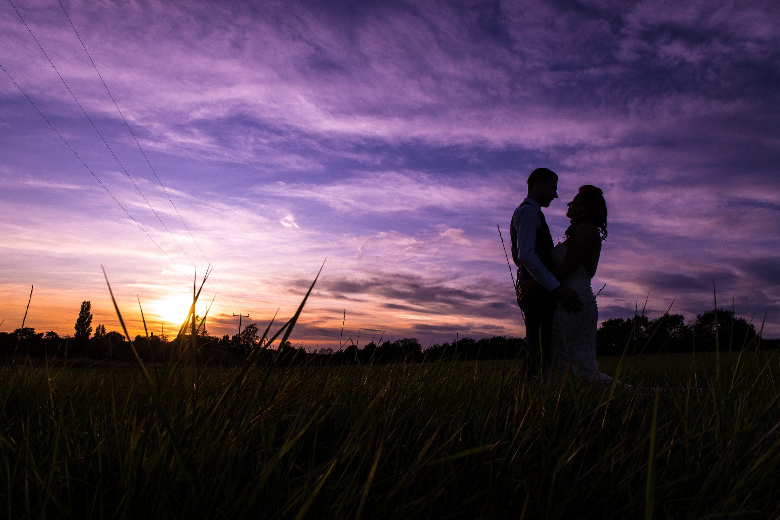 Wedding couple at sunset in Norfolk