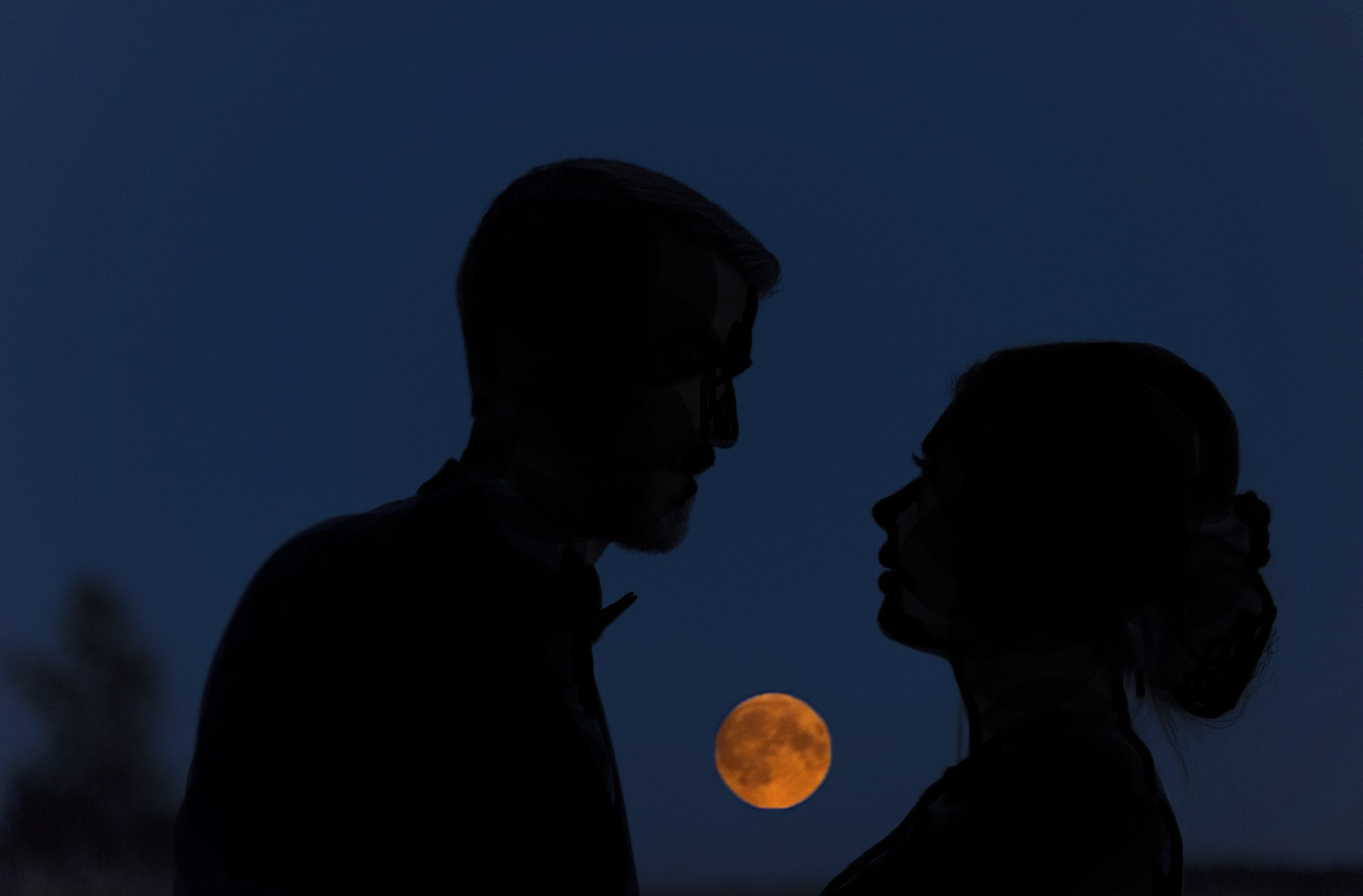 Blood Moon and bride and groom silhouette