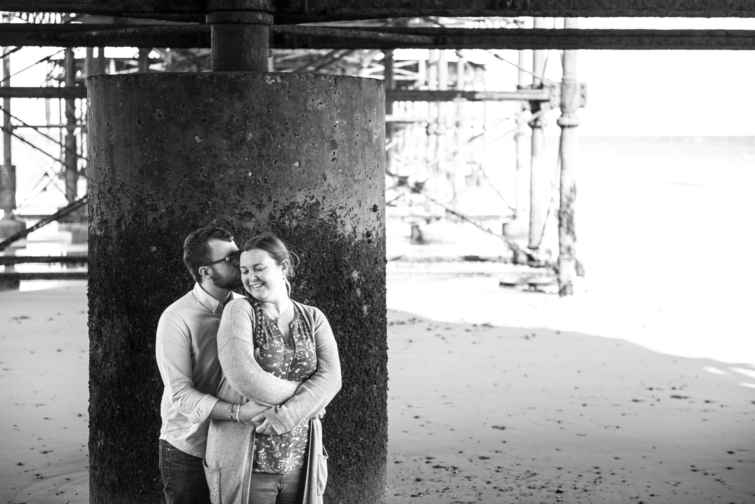 Engagement shoot snuggles on Cromer beach, Norfolk